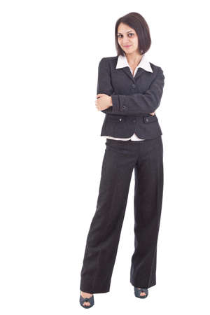 Serious business woman with crossed arms against white background  photo