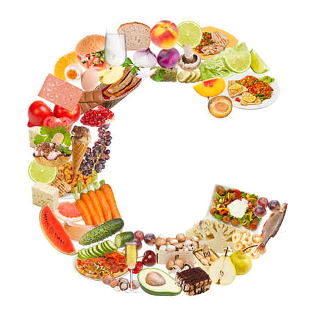 Letter C made of food isolated on white background photo