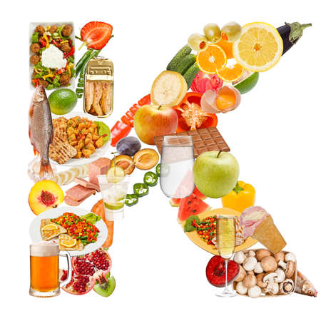 Letter K made of food isolated on white background photo