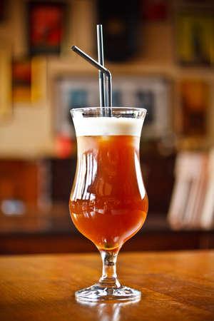 Espresso coffee with brandy, coconut liqueur cream and pineapple juice photo