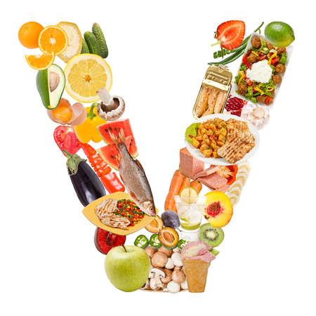 Letter V made of food isolated on white background photo