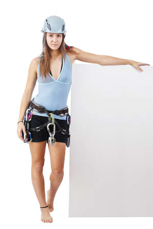 belay: Young woman in climbing equipment holding a blank cardboard Stock Photo