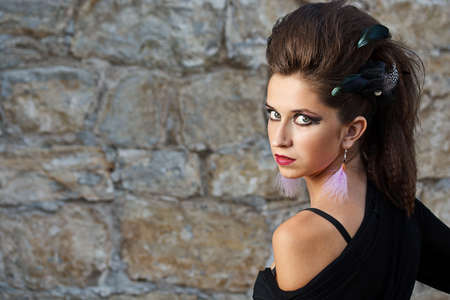 Fashion model whit beautiful make-up against old stone wall Stock Photo - 15099920