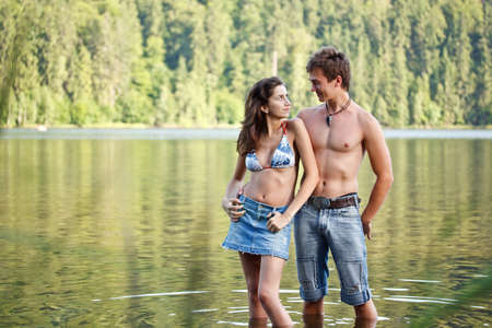 Young couple in lake water lost in love  photo