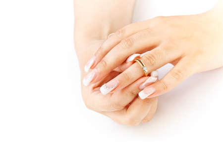 Beautiful nails with french manicure and ring  photo