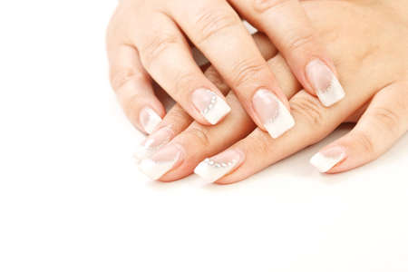 nail care: Beautiful female fingernails on white background  Stock Photo