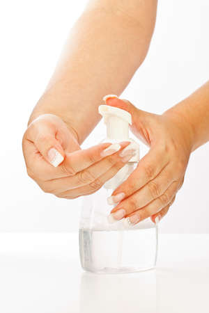 antibacterial soap: Female hands using hand soap gel pump