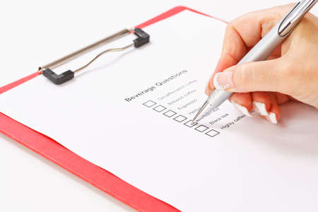 respond: Woman filling beverage question form Stock Photo
