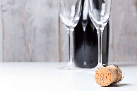 Champagne cork with background glass and bottle photo