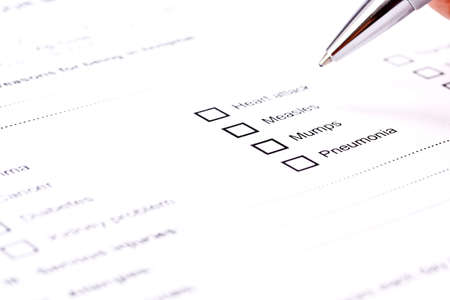 questionaire: Close up of a medical history questionaire  Stock Photo