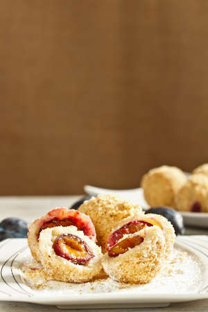 Plum dumplings coverder with breadcrumb and sprinkled with sugar photo