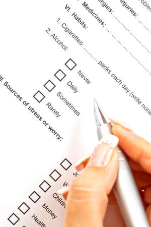 Woman filling the medical history questionnaire Stock Photo - 15328676