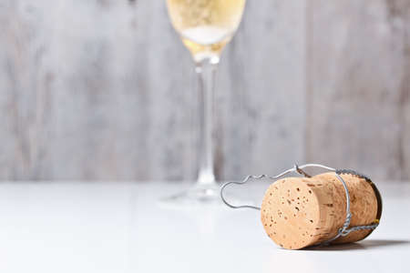 celebration champagne: Champagne glass and cork on table