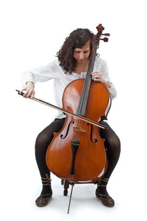 Young cellist siting and playing cello on white background