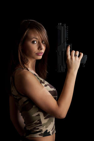 Woman bodyguard holding gun photo