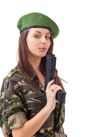 Beautiful army girl with gun isolated on white  photo