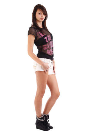 sexy teenage girls: Portrait of a nice looking girl wearing shorts, on white  Stock Photo