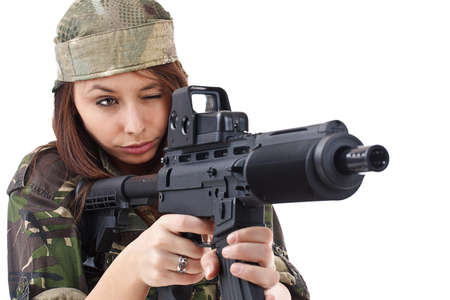 camos: Girl in action pose with gun isolated on white background Stock Photo