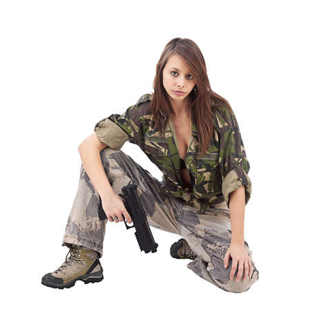 Warrior Woman in military camo, isolated on white photo