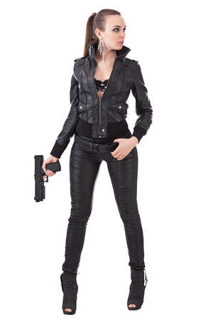 Elegant fashionable woman with a gun in hands Stock Photo - 15348258
