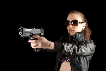 Sexy woman in black holding a revolver  photo
