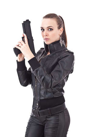 Sexy girl in black clothes with gun  photo