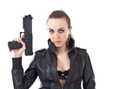 Sexy young woman with a gun isolated on white  photo