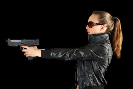 isilated: Young agent with gun isilated on black background Stock Photo