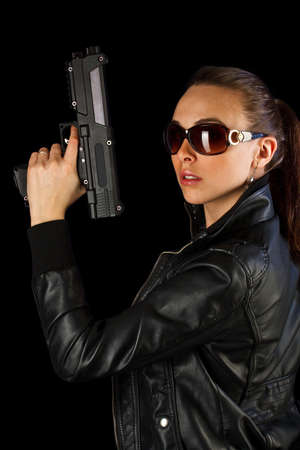 Young woman with gun in hand  photo