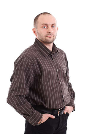 Portrait of a young businessman standing with his hands in the pockets.  photo
