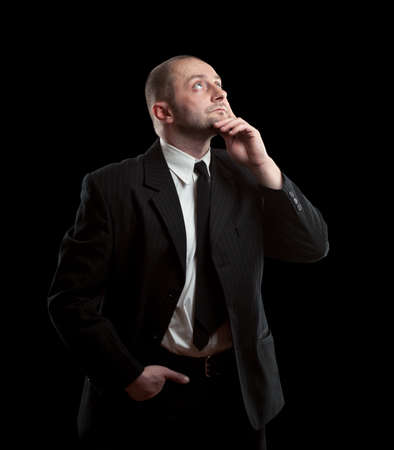 young businessman portrait on a black background Stock Photo - 15348245