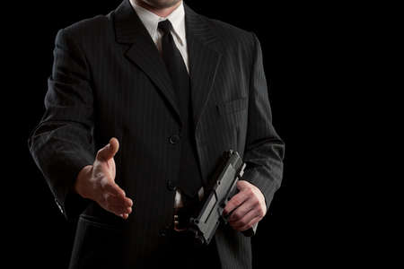 Businessman concept whit gun, isolated on black photo
