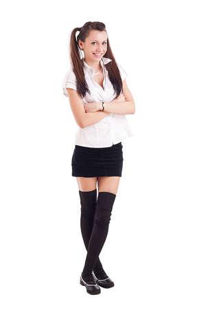 15806b803449e5 Mooie sexy meisje in zwarte korte rok tegen een witte achtergrond Stockfoto