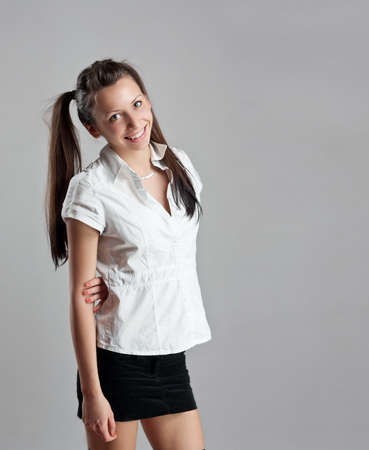 Happy teenage girl portrait, grey background photo