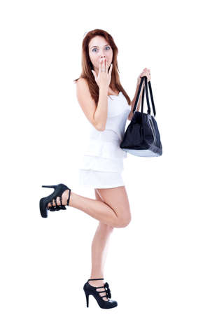 Young beautiful woman with black leather handbag, isolated on white  photo