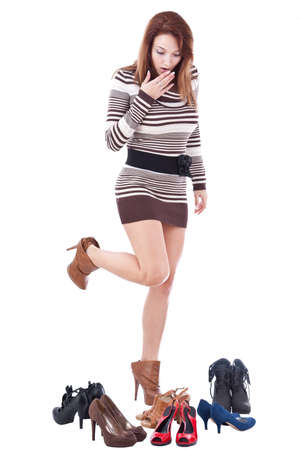 young girl feet: Happy young woman surrounded by all of her shoes  Stock Photo