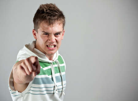 close range: Angry young man pointing his finger  Stock Photo