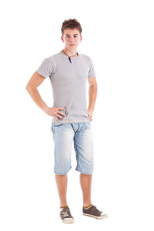Full length of a young man with hands on hips against white background Stock Photo - 15388613