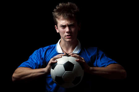 Angry soccer player with a ball  photo