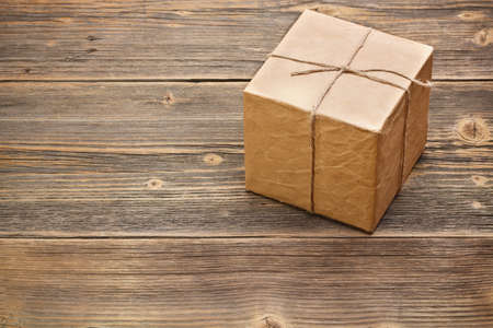 gift packs: Wrapped packaged box on wood background