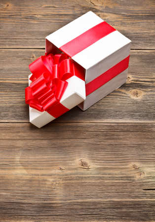 Open present box on wooden background  photo