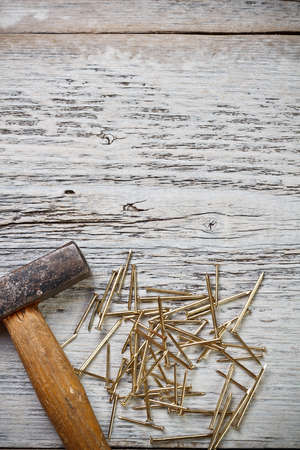 Hammer and nails on wood background photo