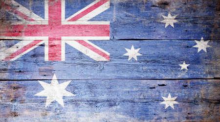 Australian National Flag painted on grungy wood plank background Stock Photo