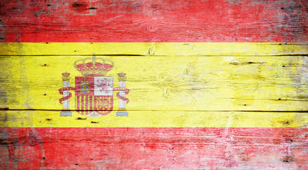 Flag of Spain painted on grungy wood plank background  photo