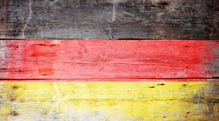 germany flag: Flag of Germany painted on grungy wood plank background