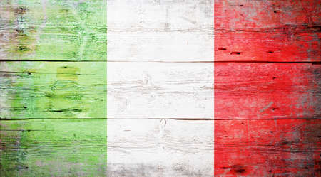 Flag of Italy painted on grungy wood plank background