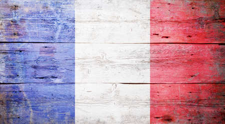 Flag of France painted on grungy wood plank background