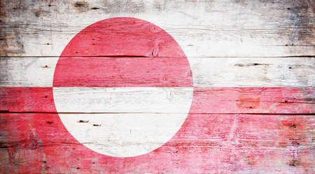 Flag of Greenland painted on grungy wood plank background  Stock Photo - 15697558