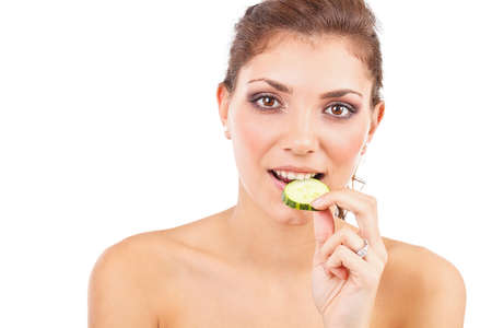 Portrait of the beautiful young woman with cucumber Stock Photo - 15859411