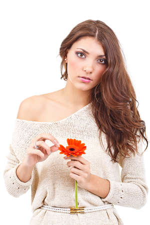 distressing: Young woman holding a flower and tearing petals
